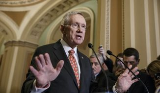 In this Dec. 2, 2014, file photo, then-Senate Majority Leader Harry Reid, D-Nev., speaks with reporters following a closed-door policy meeting at the Capitol in Washington. (AP Photo/J. Scott Applewhite, File)