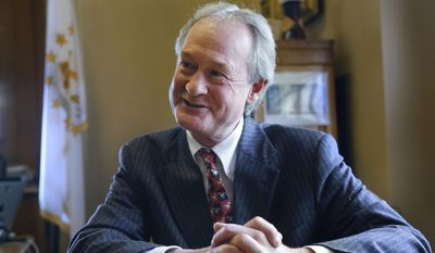 In this Thursday, Dec. 11, 2014, file photo, then-Rhode Island Gov. Lincoln Chafee responds to questions during an interview with The Associated Press, in his office at the Statehouse, in Providence, R.I. (AP Photo/Steven Senne)