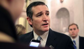 Sen. Ted Cruz, Texas Republican, talks with reporters after the Senate voted on a $1.1 trillion spending bill to fund the government through the next fiscal year on Saturday, Dec. 13, 2014, on Capitol Hill in Washington. (AP Photo/Lauren Victoria Burke) ** FILE **