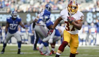 Washington Redskins Chris Thompson takes the ball into the end zone for a touchdown against the New York Giants during the second quarter of an NFL football game, Sunday, Dec. 14, 2014, in East Rutherford, N.J. (AP Photo/Julio Cortez)