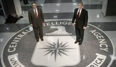 President George W. Bush and CIA director George J. Tenet pose on the CIA seal in the entrance of agency headquarters in Langley, Virginia. (Associated Press)