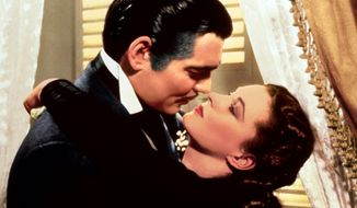 """Clark Gable, left, appears in character as Rhett Butler and Vivien Leigh as Scarlett O'Hara, in the film """"Gone with the Wind."""" (AP Photo/Turner Classic Movies) ** FILE **"""