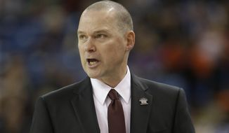Sacramento Kings head coach Michael Malone calls out instructions to his team during the fourth quarter of an NBA basketball game against the Detroit Pistons in Sacramento, Calif., Saturday, Dec. 13, 2014. The Pistons won 95-90. (AP Photo/Rich Pedroncelli)