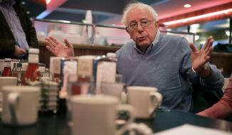 Sen. Bernie Sanders, I-Vt., speaks to local residents during a breakfast meeting, Tuesday, Dec. 16, 2014, at the Drake Diner in Des Moines, Iowa. (AP Photo/Charlie Neibergall)