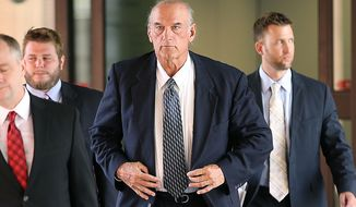 FILE - In this July 8, 2014 file photo former Minnesota Gov. Jesse Ventura, center, leaves federal court in St. Paul, Minn. Ventura, who was awarded $1.8 million in a defamation lawsuit against author Chris Kyle's estate, is suing HarperCollins saying publicity about the book and Kyle's claims about him generated millions of dollars in profits for the publisher. (AP Photo/The Star Tribune, Elizabeth Flores, File)
