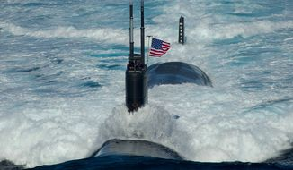 The Los Angeles-class attack submarine USS Tuscon (SSN 770) transits the East Sea while leading a 13-ship formation. (U.S. Navy photo by Mass Communication Specialist 3rd Class Adam K. Thomas/Released)