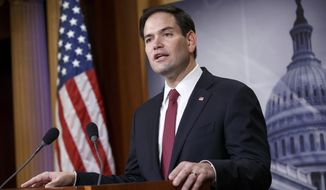 Sen. Marco Rubio, R-Fla., the son of Cuban immigrants, expresses his disappointment in President Barack Obama's initiative to normalize relations between the U.S. and Cuba, Wednesday, Dec. 17, 2014, during a news conference on Capitol Hill in Washington. (AP Photo/J. Scott Applewhite) ** FILE **