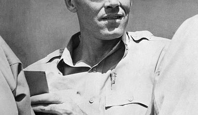 Lieutenant Henry Fonda, former Hollywood movie star, relaxes in a South Pacific area, July 10, 1944 where he is now on active duty on the staff of Vice Adm. J.H. Hoover, U.S. Navy commander of the forward area, Central Pacific. Fonda joined the navy as an ordinary seaman. (AP Photo)