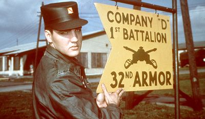 """Elvis Presley was inducted into the U.S. Army as a private at Fort Chaffee, near Fort Smith, Arkansas. His arrival was a major media event. Hundreds of people descended on Presley as he stepped from the bus; photographers then accompanied him into the fort.  Presley announced that he was looking forward to his military stint, saying he did not want to be treated any differently from anyone else: """"The Army can do anything it wants with me."""" Soon after Presley commenced basic training at Fort Hood, Texas, he received a visit from Eddie Fadal, a businessman he had met on tour. According to Fadal, Presley had become convinced his career was finished-""""He firmly believed that."""" But then, during a two-week leave in early June, Presley recorded five songs in Nashville. In early August, his mother was diagnosed with hepatitis and her condition rapidly worsened. Presley, granted emergency leave to visit her, arrived in Memphis on August 12. Two days later, she died of heart failure, aged 46. Presley was devastated; their relationship had remained extremely close--even into his adulthood, they would use baby talk with each other and Presley would address her with pet names. After training, Presley joined the 3rd Armored Division in Friedberg, Germany, on October 1.  Introduced to amphetamines by a sergeant while on maneuvers, he became """"practically evangelical about their benefits"""" - not only for energy, but for """"strength"""" and weight loss, as well - and many of his friends in the outfit joined him in indulging. The Army also introduced Presley to karate, which he studied seriously, later including it in his live performances.  Fellow soldiers have attested to Presley's wish to be seen as an able, ordinary soldier, despite his fame, and to his generosity. He donated his Army pay to charity, purchased TV sets for the base, and bought an extra set of fatigues for everyone in his outfit. Elvis Presley is shown in uniform at company D 1st Battalion 32nd U.S. Army Armour at the barr"""