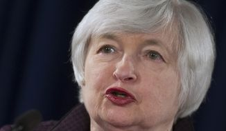 Federal Reserve Chair Janet Yellen makes a statement on jobs and economic outlook, Wednesday, Dec. 17, 2014, at the Federal Reserve in Washington. The U.S. economy is finally doing better, and the Federal Reserve may be ready to acknowledge that fact.   (AP Photo/Cliff Owen)