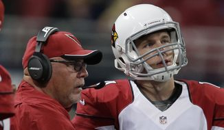 FILE - In this Dec. 11, 2014, file photo, Arizona Cardinals head coach Bruce Arians talks with quarterback Ryan Lindley (14) during the second half of an NFL football game against the St. Louis Rams  in St. Louis. Arians cut quarterback Ryan Lindley at the end of preseason. Now he's put the offense in Lindley's hands in the biggest game of the Cardinals' season. (AP Photo/Darron Cummings, File)