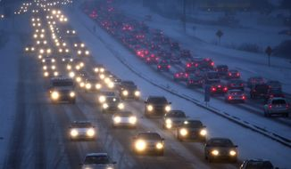 FILE - In this Tuesday, Feb. 1, 2011 file photo, traffic on U.S. Highway 12/14 in Madison, Wis. moves at a crawl as drivers navigate accumulating snows and high winds. Traffic fatalities are continuing to decline across Wisconsin and are on track to account for the lowest number of road deaths since 1943, transportation officials say. As of Wednesday, there have been 480 fatalities so far this year, compared to 527 in 2013, according to Wisconsin Department of Transportation data. (AP Photo/Wisconsin State Journal, John Hart, File)