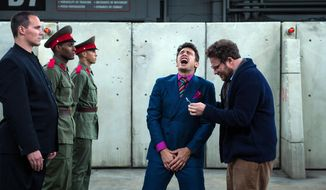 "This photo provided by Columbia Pictures - Sony shows, James Franco, center, as Dave, and Seth Rogen, right, as Aaron, in Columbia Pictures' ""The Interview."" (AP Photo/Columbia Pictures - Sony, Ed Araquel)"