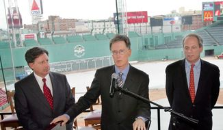 John Henry, principal owner of Boston Red Sox, center, speaks during a news conference at Fenway Park in Boston, Wednesday, March 23, 2005. Boston Red Sox president CEO Larry Lucchino, right, and chairman Tom Werner, left, look on. (AP Photo/Chitose Suzuki) ** FILE**