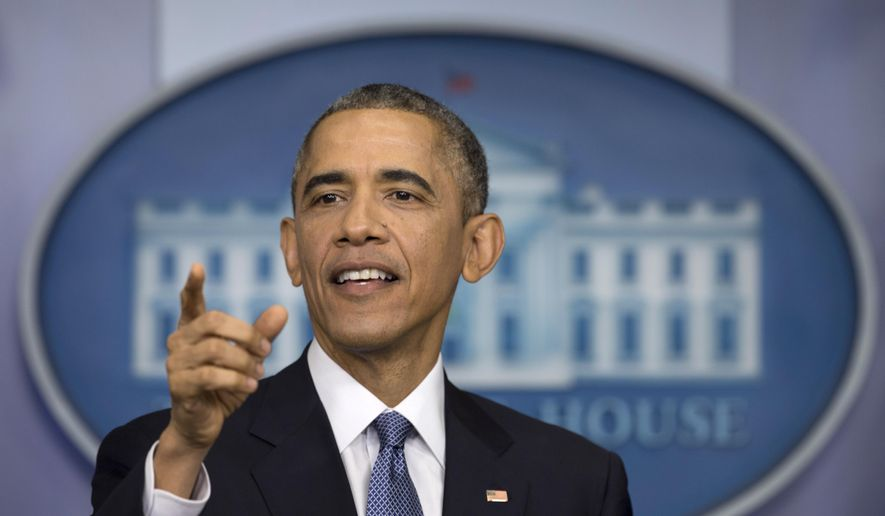 President Barack Obama gestures during a news conference in the Brady Press Briefing Room of the White House in Washington, Friday, Dec. 19, 2014. The president claimed an array of successes in 2014, citing lower unemployment, a rising number of Americans covered by health insurance, and an historic diplomatic opening with Cuba. He also touts his own executive action and a Chinese agreement to combat global warming. (AP Photo/Carolyn Kaster) ** FILE **
