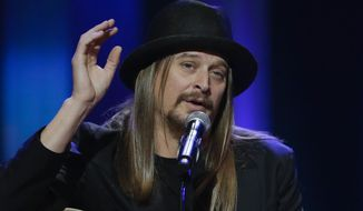 This May 2, 2013, file photo shows Kid Rock speaking during the funeral for country music star George Jones at the Grand Ole Opry House in Nashville, Tenn. (AP Photo/Mark Humphrey, Pool)
