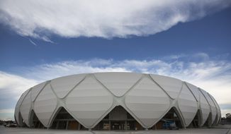 FILE - In this May 20, 2014 file photo, Arena da Amazonia stands in Manaus, Brazil. The 44,000-capacity stadium in the jungle city of Manaus, which has no teams in the first, second or third divisions, hosted 11 events since the end of the World Cup in July. Brazil is still trying to find ways to take advantage of some of its new arenas. (AP Photo/Felipe Dana, File)