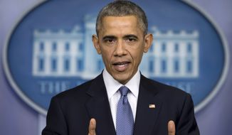 President Barack Obama speaks during a news conference in the Brady Press Briefing Room of the White House in Washington, Friday, Dec. 19, 2014. The president claimed an array of successes in 2014, citing lower unemployment, a rising number of Americans covered by health insurance, and an historic diplomatic opening with Cuba. He also touts his own executive action and a Chinese agreement to combat global warming. (AP Photo/Carolyn Kaster)