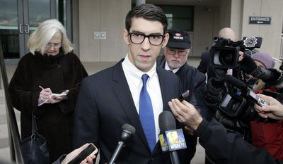 Olympic swimmer Michael Phelps speaks with reporters after he walked out of a courthouse where he pleaded guilty to drunken driving, Friday, Dec. 19, 2014, in Baltimore. He was sentenced to a year in prison for the Sept. 30 arrest, but the prison sentence is suspended. He must be on probation for a year and a half.(AP Photo/Patrick Semansky)