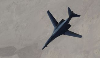 A B-1B Lancer after refueling during U.S.-led airstrikes on ISIS targets in Syria. Military intervention alone won't avert violent upheaval in the Middle East, says Nasir Shansab. (AP Photo/Staff Sgt. Ciara Wymbs, U.S. Air Force)