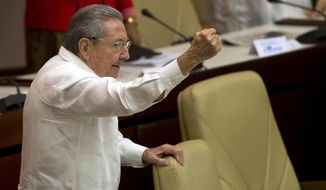 Cuba's President Raul Castro raises his fist and shout's during the closing of the twice-annual legislative session at the National Assembly in Havana, Cuba, Saturday, Dec. 20, 2014. (Associated Press) ** FILE **