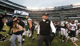 New York Jets head coach Rex Ryan leaves the field after an NFL football game against the New England Patriots Sunday, Dec. 21, 2014, in East Rutherford, N.J. The Patriots won the game 17-16. (AP Photo/Julio Cortez)