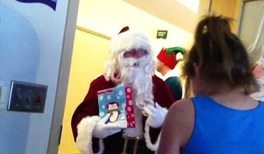 Former President George W. Bush quietly disguised himself as Santa Claus and handed out toys at the Children's Medical Center of Dallas last week. (Facebook/Shayde and Emily Hearts 4/2)