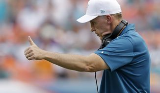 Miami Dolphins head coach Joe Philbin give a thumbs up after defensive end Cameron Wake sacked Minnesota Vikings quarterback Teddy Bridgewater during the second half of an NFL football game, Sunday, Dec. 21, 2014 in Miami Gardens, Fla. The Dolphins defeated the Vikings 37-35. (AP Photo/Wilfredo Lee)