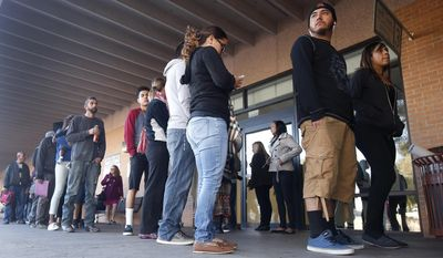 A line stretches outside an a Arizona Department of Transportation Motor Vehicle Division office, as many young immigrants protected from deportation under new Obama administration policies begin pursuing Arizona driver's licenses, Monday, Dec. 22, 2014, in Phoenix. (AP Photo/Ross D. Franklin) ** FILE **