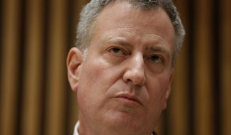 New York City Mayor Bill de Blasio listens to questions during a news conference at police headquarters in New York, Monday, Dec. 22, 2014. De Blasio called Monday for a pause in protests over police conduct as he faced a widening rift with those in a grieving force who accuse him of creating a climate of mistrust that contributed to the execution of two officers. (AP Photo/Seth Wenig)
