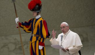 Pope Francis delivers his speech during an audience with the Holy See's employees in the Paul VI hall at the Vatican, Monday, Dec. 22, 2014. (AP Photo/Alessandra Tarantino)