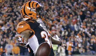 Cincinnati Bengals running back Jeremy Hill celebrates after running 85 yards for a touchdown during the first half of an NFL football game against the Denver Broncos on Monday, Dec. 22, 2014, in Cincinnati. (AP Photo/AJ Mast)