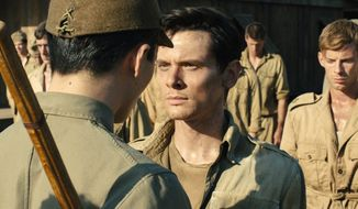 "Jack O'Connell portrays Olympian and war hero Louis ""Louie"" Zamperini in ""Unbroken,"" directed by Angelina Joile. ""Unbroken"" is a movie about pain, but it is also a movie about will and perseverance. (Associated Press)"