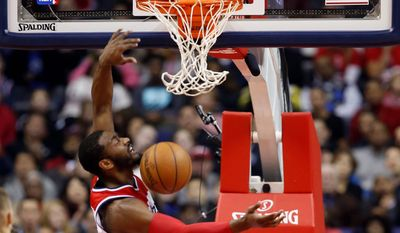 Guard John Wall leads the Wizards into Madison Square Garden against the New York Knicks in the first of five NBA games on Christmas, confirming the Wizards' rise in panache. (Associated Press)