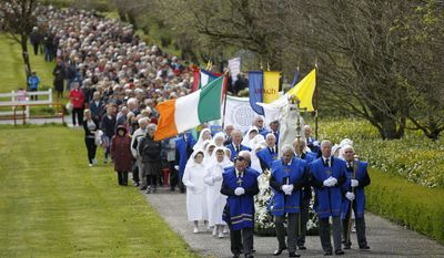 In this Saturday, May 4, 2013 file photo, thousands of Roman Catholics take part in a Rosary Procession at Knock Shrine, Ireland. (AP Photo/Peter Morrison, File)