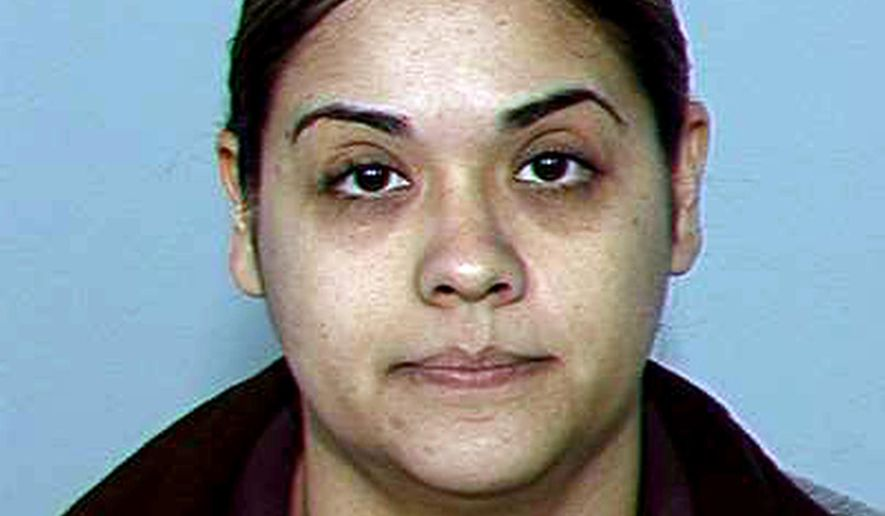 This undated photo provided by the Maricopa County Sheriff's Office shows Sylvia Najera a former jail officer who is accused of helping launder a smuggling ring's drug proceeds. The disappearance of a key wiretap document in an Arizona corruption case has led prosecutors to seek the dismissal of charges against Najera a former sheriff's officer accused of helping a cartel-connected heroin smuggling ring. (AP Photo/Maricopa County Sheriff)