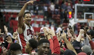UNLV guard Rashad Vaughn celebrates a 71-67 victory over Arizona after an NCAA college basketball game Tuesday, Dec. 23, 2014, in Las Vegas. (AP Photo/Eric Jamison)