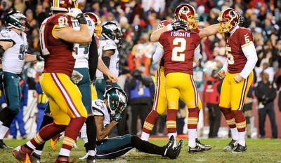 Washington Redskins kicker Kai Forbath (2) kicks the game winning field goal as the Washington Redskins play the Philadelphia Eagles at FedEx Field, Landover, Md., Saturday, December 20, 2014. (Andrew Harnik/The Washington Times)