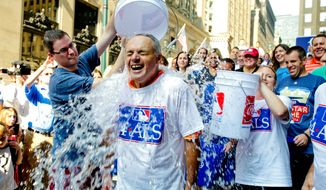 Major League Baseball Commissioner-elect Rob Manfred participates in the ALS ice bucket challenge outside the organization's headquarters in New York in August. The campaign raised $115 million through the ice bucket challenge. (Associated Press)