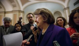 """Senate Intelligence Committee Chair Sen. Dianne Feinstein, D-Calif. speaks to reporters as she leaves the Senate chamber on Capitol Hill in Washington, Tuesday, Dec. 9, 2014, following her release of a report on the CIA's harsh interrogation techniques at secret overseas facilities after the 9/11 terror attacks. Feinstein  branded the findings a """"stain on the nation's history."""" (AP Photo/J. Scott Applewhite)"""