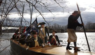 George Washington, played by John Godzieba, standing center, holds onto his hat as he and his troops land in Titusville, N.J., after crossing the Delaware River during the 62nd annual reenactment of Washington's daring Christmas 1776 crossing of the river - the trek that turned the tide of the Revolutionary War - Thursday, Dec. 25, 2014, in Washington Crossing, Pa. (AP Photo/Mel Evans)