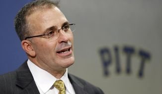 Pat Narduzzi, the former longtime Michigan State defensive coordinator, speaks at a news conference in Pittsburgh where he was introduced as the new head football coach at the University of Pittsburgh, Friday, Dec. 26, 2014. Narduzzi replaces Paul Chryst, who left Pitt last week after three seasons to become the coach at Wisconsin.(AP Photo/Keith Srakocic)