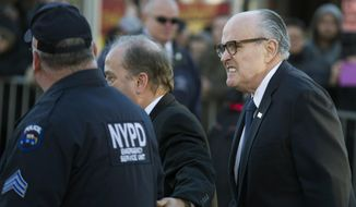 Former Mayor of New York City Rudy Giuliani arrives at the wake of officer Rafael Ramos at Christ Tabernacle Church, in the Glendale section of Queens, Friday, Dec. 26, 2014, in New York. Ramos was killed Dec. 20 along with his partner, Officer Wenjian Liu, as they sat in their patrol car on a Brooklyn street. The shooter, Ismaaiyl Brinsley, later killed himself. (AP Photo/John Minchillo)