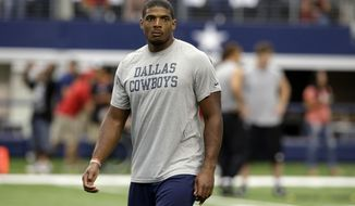 This photo taken Sept. 7, 2014, shows former Dallas Cowboys Michael Sam walking on the field before the first half of an NFL football game in Arlington, Texas. (AP Photo/LM Otero)