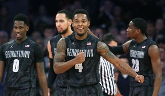 Georgetown guard D'Vauntes Smith-Rivera (4) reacts by pounding his chest as Georgetown pulls ahead of Indiana in the second half of an NCAA college basketball game at Madison Square Garden in New York, Saturday, Dec. 27, 2014. Georgetown defeated Indiana 91-87 in overtime.  (AP Photo/Kathy Willens)