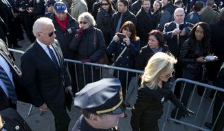 Vice President Joe Biden, left, and his wife Jill Biden arrive for the funeral of New York City police officer Rafael Ramos at Christ Tabernacle Church in the Glendale section of Queens, Saturday, Dec. 27, 2014, in New York. Ramos and his partner, officer Wenjian Liu, were killed Dec. 20 as they sat in their patrol car on a Brooklyn street. The shooter, Ismaaiyl Brinsley, later killed himself.  (AP Photo/Craig Ruttle)