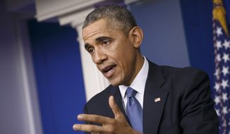 President Obama speaks during a news conference in the Brady Press Briefing Room of the White House in Washington on Dec. 19, 2014. (Associated Press) **FILE**
