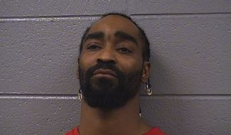 Aries Woodfin, 33, has been charged after online threats against police reportedly led authorities to search a suburban home where they found a makeshift gun range and several rounds of ammunition. (Cook County Sheriff)