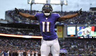 Baltimore Ravens wide receiver Kamar Aiken celebrates after scoring a touchdown in the second half of an NFL football game against the Cleveland Browns, Sunday, Dec. 28, 2014, in Baltimore. (AP Photo/Gail Burton)