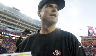 San Francisco 49ers head coach Jim Harbaugh walks off the field after an NFL football game against the Arizona Cardinals in Santa Clara, Calif., Sunday, Dec. 28, 2014. The 49ers won 20-17. (AP Photo/Marcio Jose Sanchez)